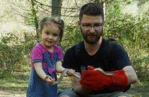 Ilian Velikov and his daughter with a Ladder Snake (Rhinechis scalaris), Sant Cugat